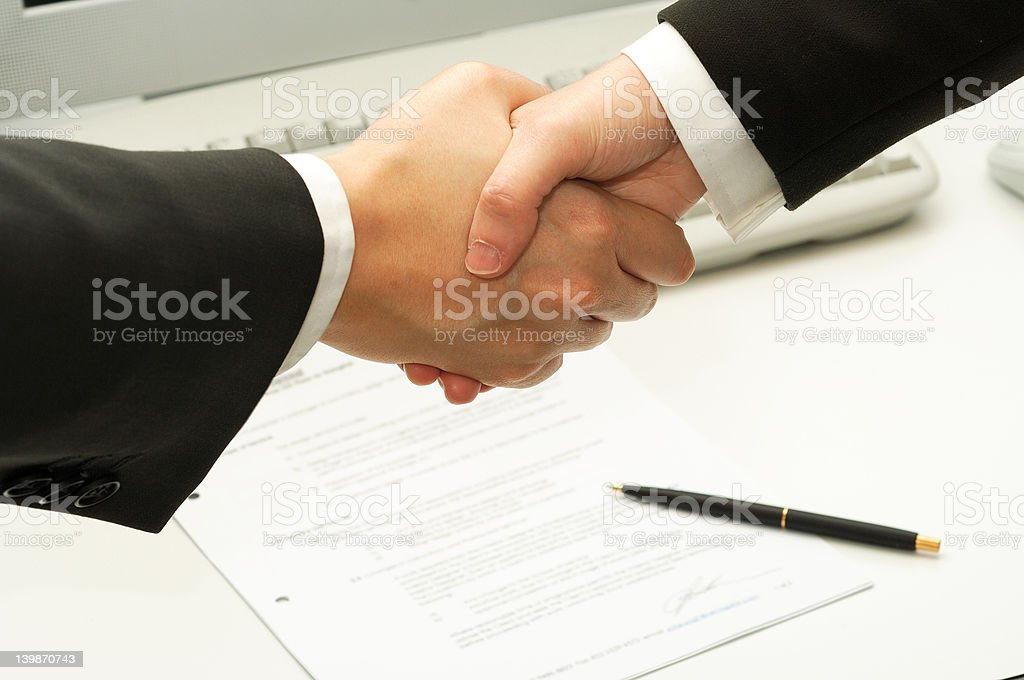 business man shake hands after signing a contract royalty-free stock photo
