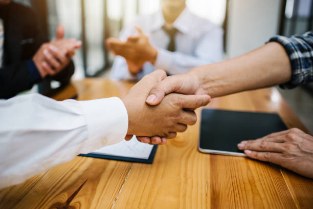 Business man shaking hands to work corporate meeting. stock photo