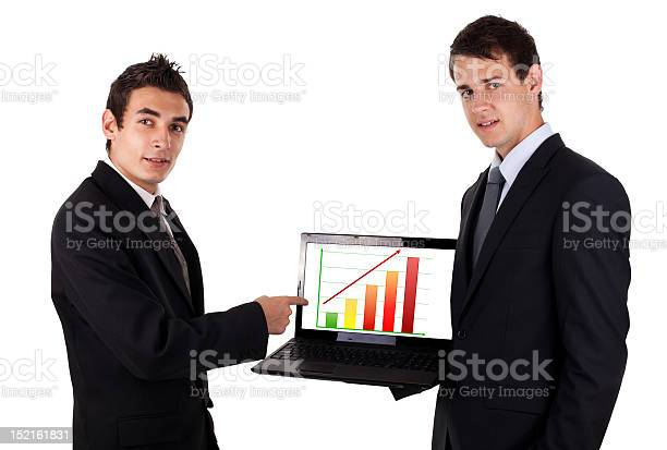 Business Man Show On Laptop With Chart Stock Photo - Download Image Now