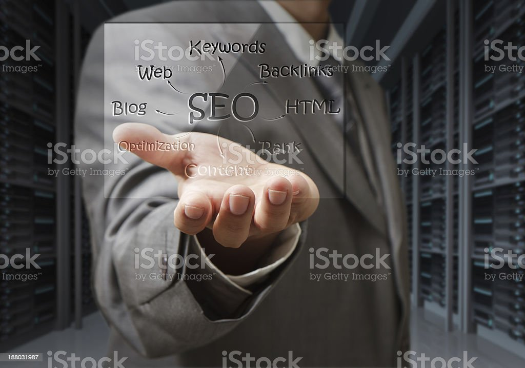 business man show seo diagram shield in server room royalty-free stock photo