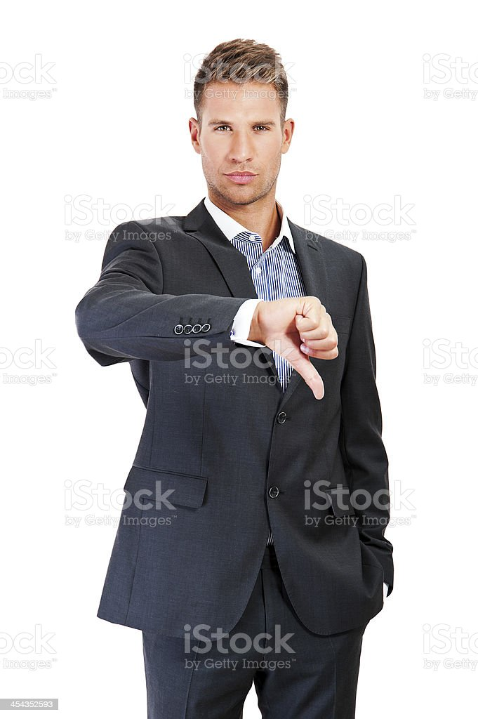 Business man showing a thumb down gesture stock photo