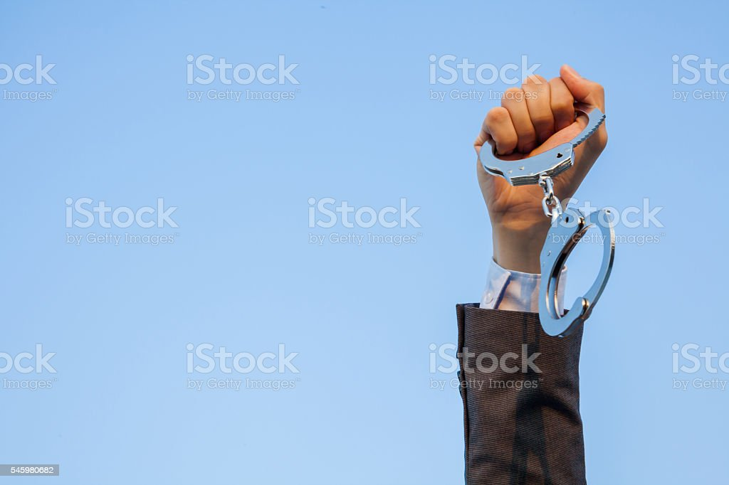 Business man showing handcuffs after releasing it. Financial freedom concept stock photo