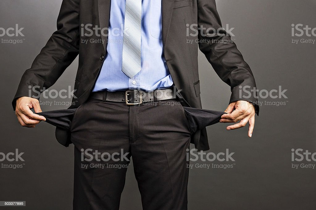 Business man showing his empty pockets stock photo
