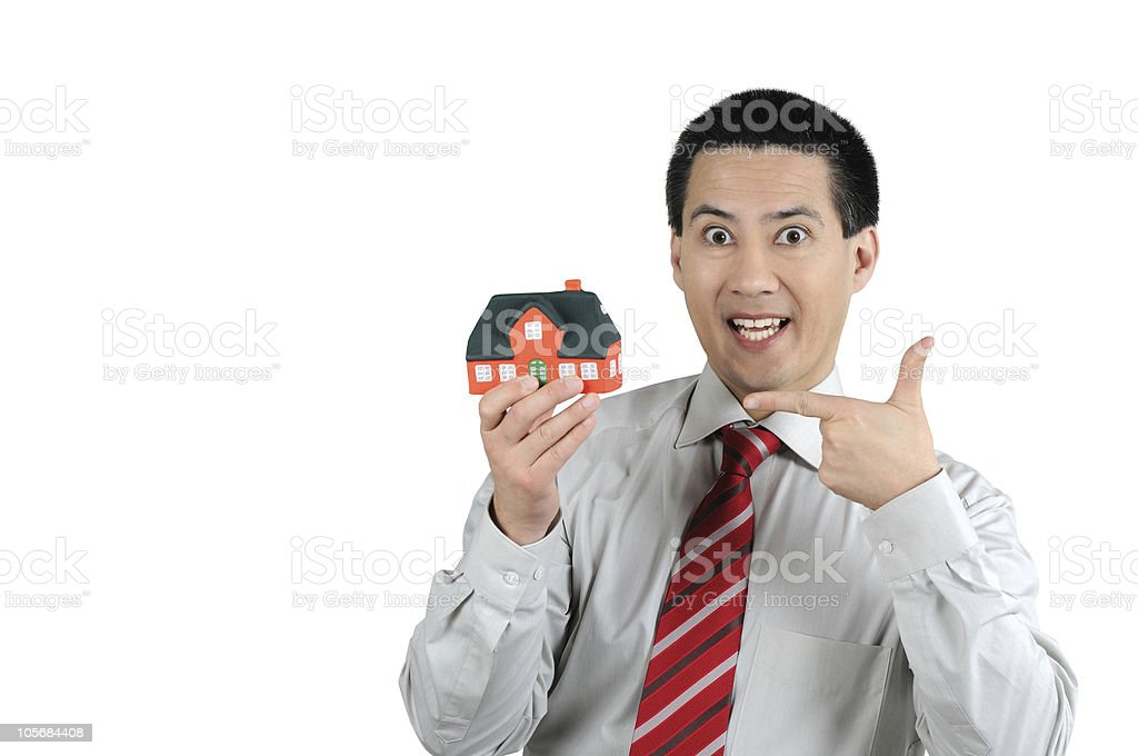 Business Man showing House stock photo