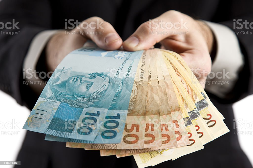 Business man showing money. stock photo