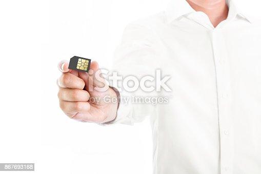 istock business man showing sim card 867693168
