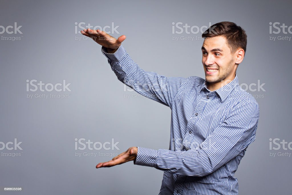 Business man showing something on gray background stock photo