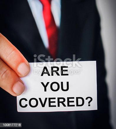Business man showing texts of Insurance concept on paper