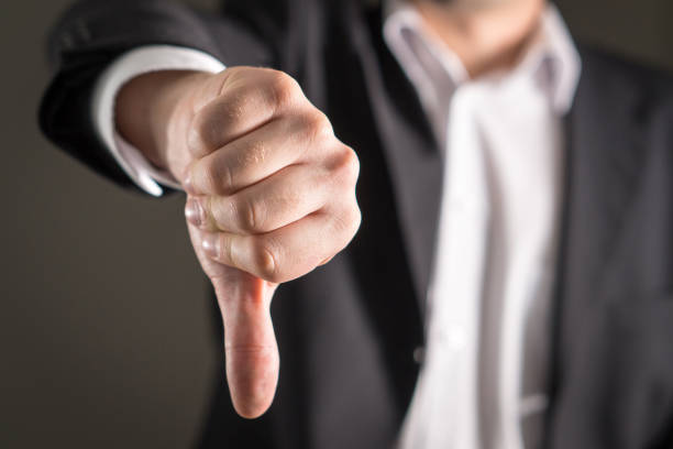 Business man showing thumbs down. Businessman showing thumbs down. rejection stock pictures, royalty-free photos & images