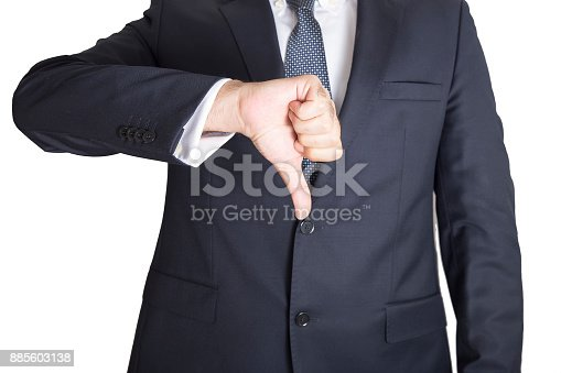 Business man showing thumbs down.
