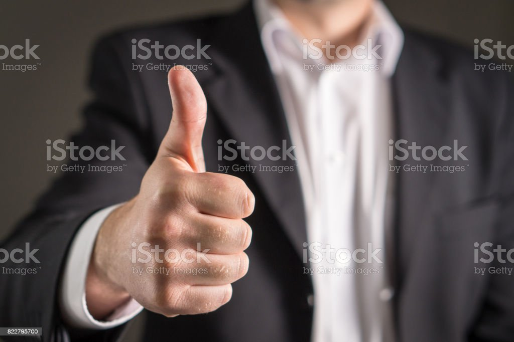 Business man showing thumbs up. stock photo