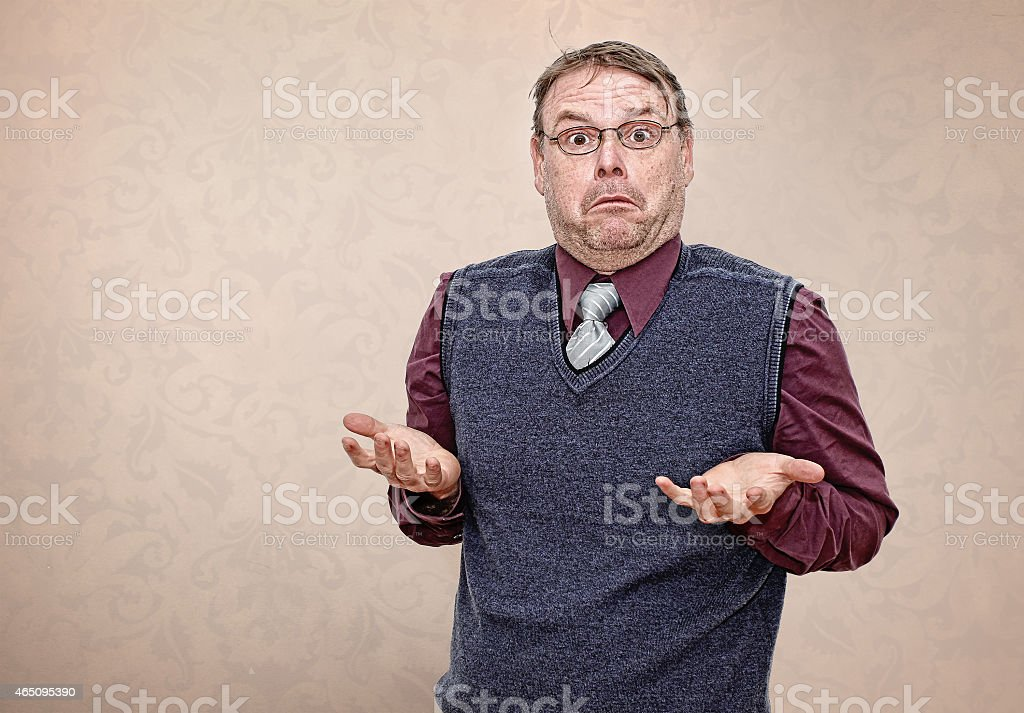Business Man Shrugging his Shoulders stock photo