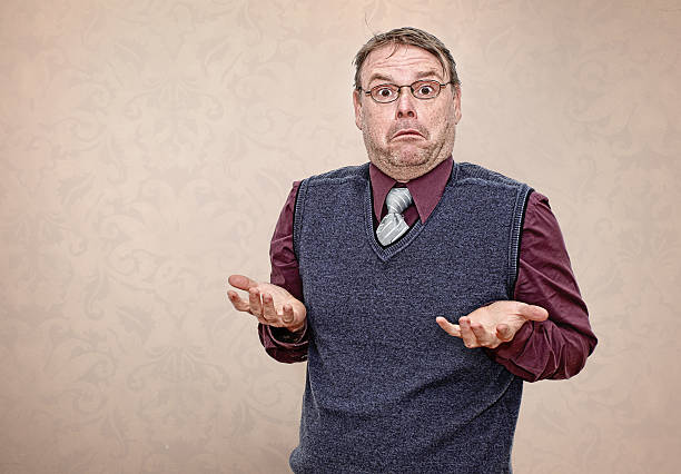 Business Man Shrugging his Shoulders Portrait of a Confused Business Man Shrugging his Shoulders shrugging stock pictures, royalty-free photos & images