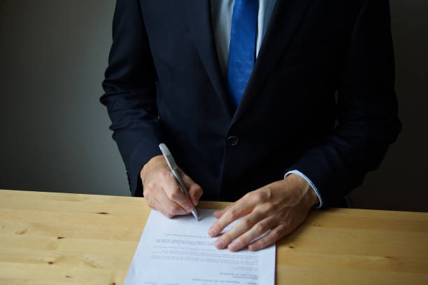 Business man signing a contract stock photo