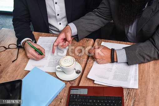 501040002istockphoto Business man signing a contract 1133787571
