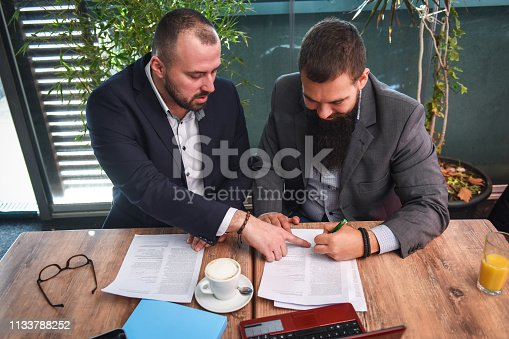 501040002istockphoto Business man signing a contract 1133788252