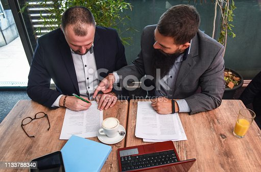 501040002istockphoto Business man signing a contract 1133788340