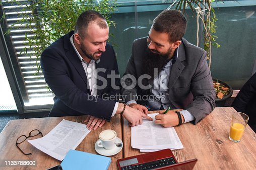 501040002istockphoto Business man signing a contract 1133788600