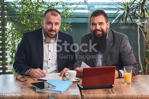 501040002istockphoto Business man signing a contract 1133788703