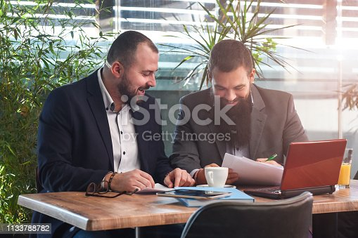 501040002istockphoto Business man signing a contract 1133788782