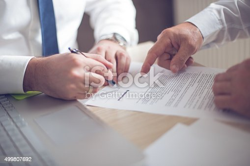 501040002istockphoto Business man signing a contract 499807692