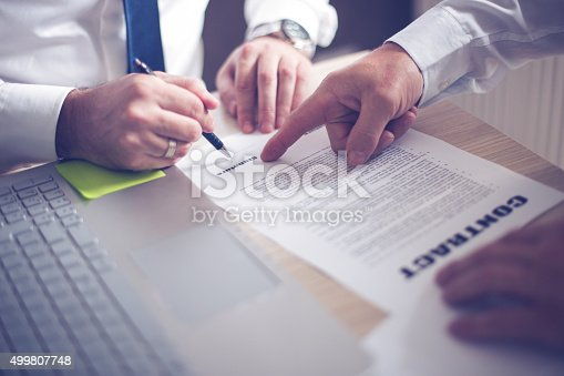 501040002istockphoto Business man signing a contract 499807748