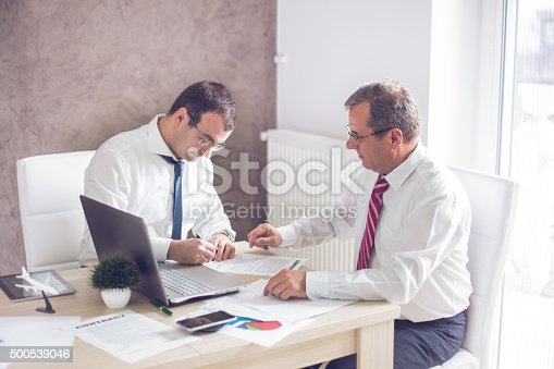 501040002istockphoto Business man signing a contract 500539046