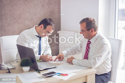 501040002istockphoto Business man signing a contract 500539138
