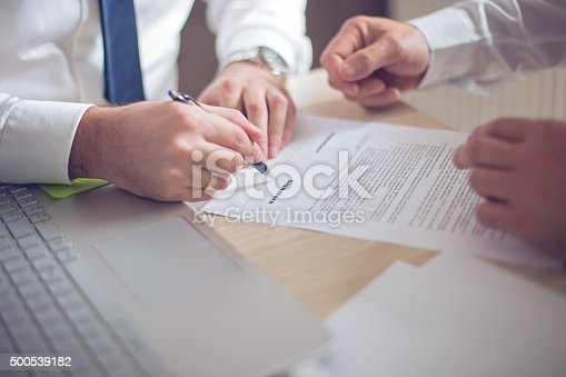 501040002istockphoto Business man signing a contract 500539182