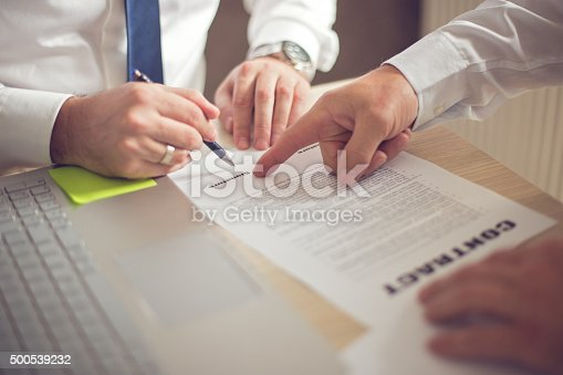 501040002istockphoto Business man signing a contract 500539232