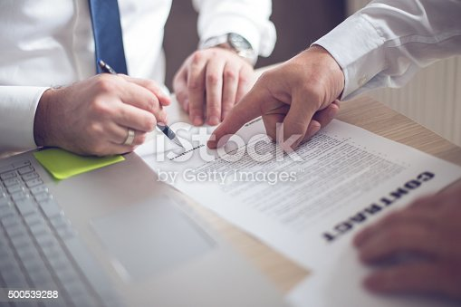 501040002istockphoto Business man signing a contract 500539288