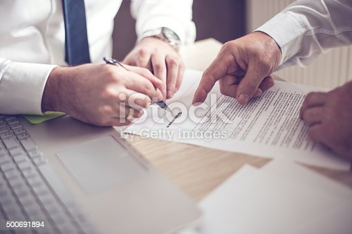 501040002istockphoto Business man signing a contract 500691894