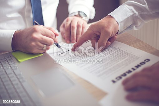 501040002istockphoto Business man signing a contract 500880988