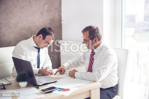 501040002istockphoto Business man signing a contract 500924770