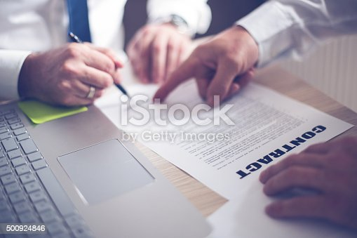 501040002istockphoto Business man signing a contract 500924846