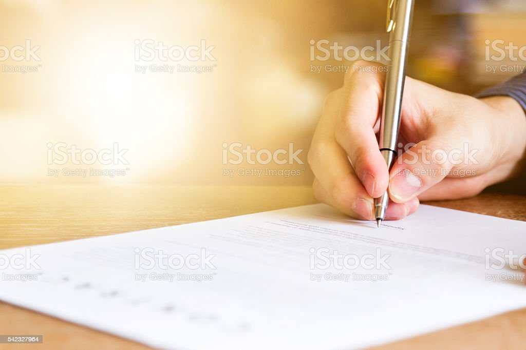 business man signing contract document business man signing contract document on office desk Adult Stock Photo