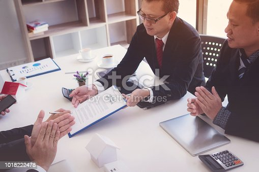 638881988istockphoto Business man signing contract for new owner of house. Real estate broker sell house. 1018222478