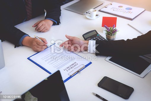 1008974324 istock photo Business man signing contract for new owner of house. Real estate broker sell house. 1018223196