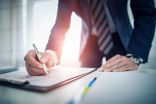 istock Business man signing contract, making a deal. 840632770