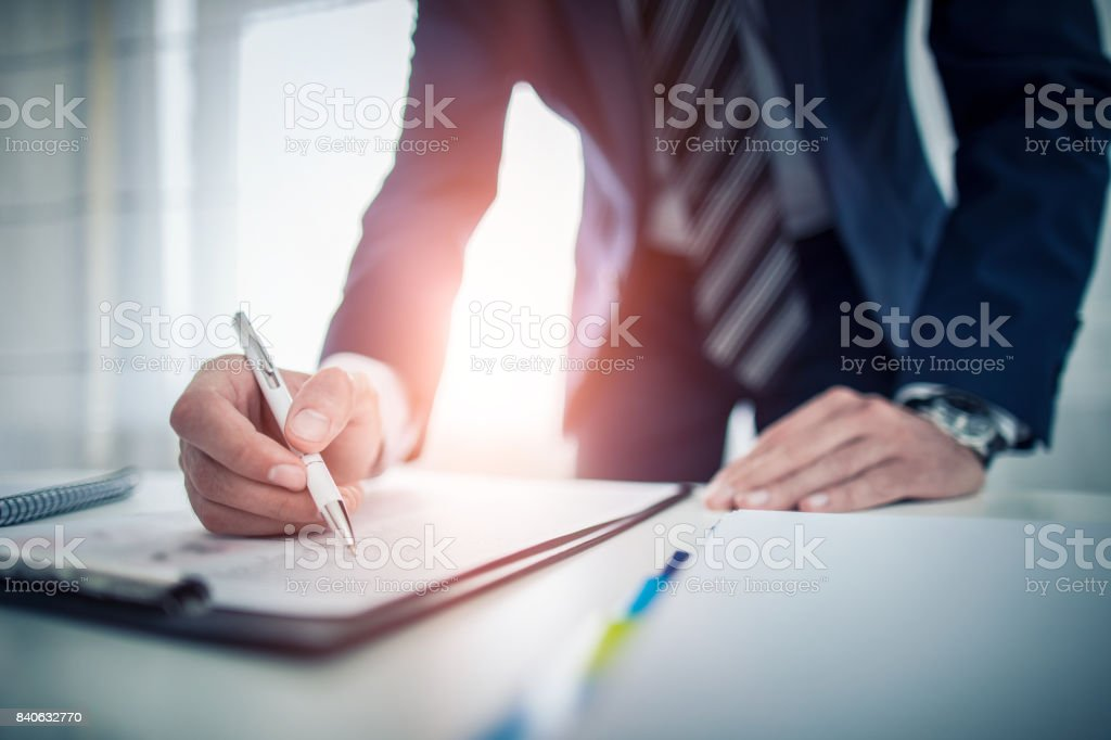 Business man signing contract, making a deal. stock photo