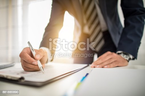 istock Business man signing contract, making a deal. 881885890