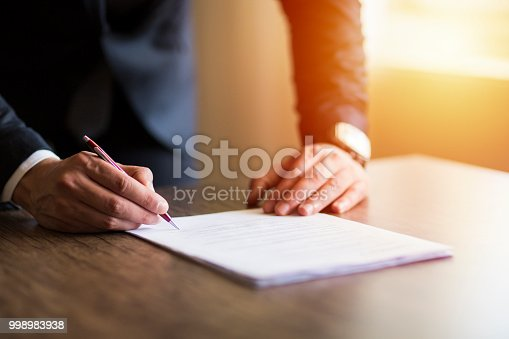 Business man signing contract, making a deal