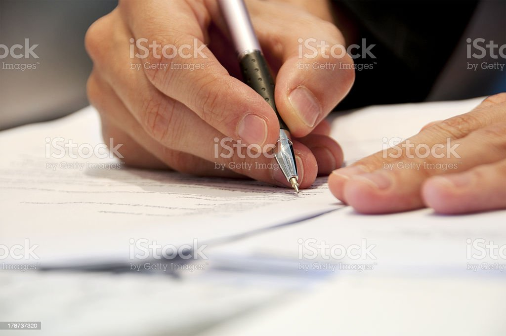Business Man Signing Documents stock photo