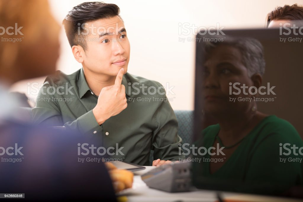 Business man signing during team meeting. stock photo