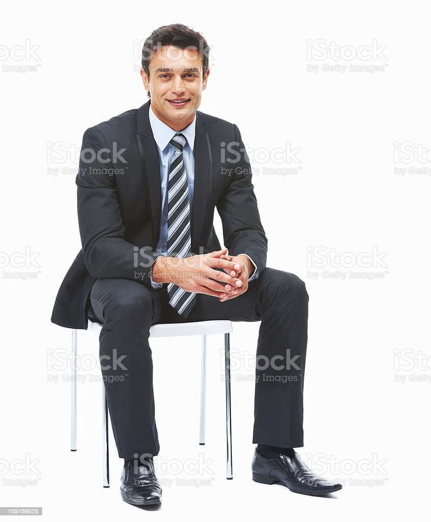 Business man sitting against white background stock photo