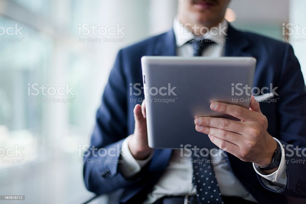Business man sitting at airport royalty-free stock photo