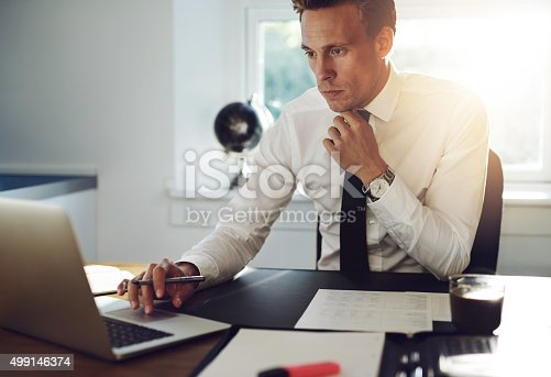 istock Business man sitting at his desk 499146374