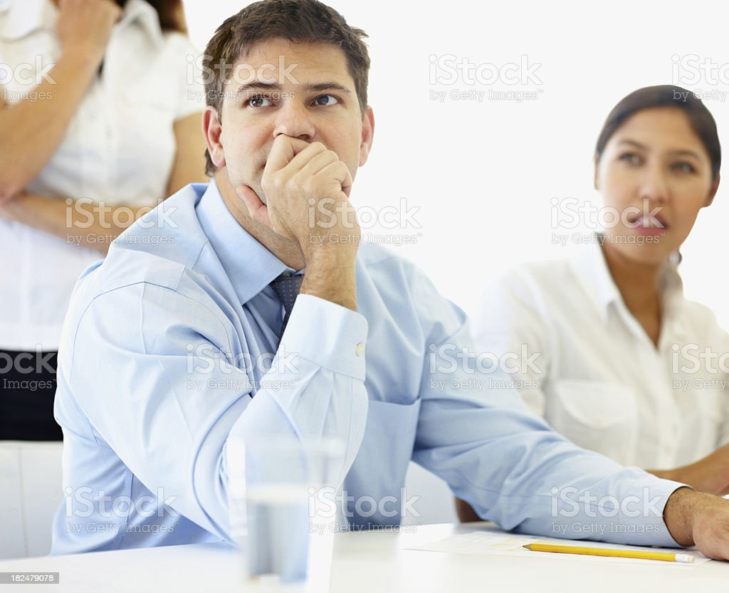 Business man sitting attentively at a meeting royalty-free stock photo