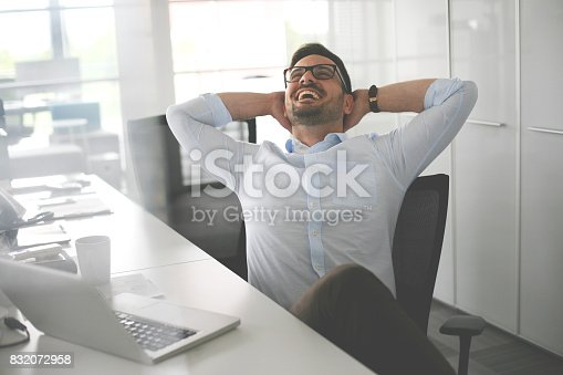 istock Business man sitting in office and stretched. Business man having break. 832072958