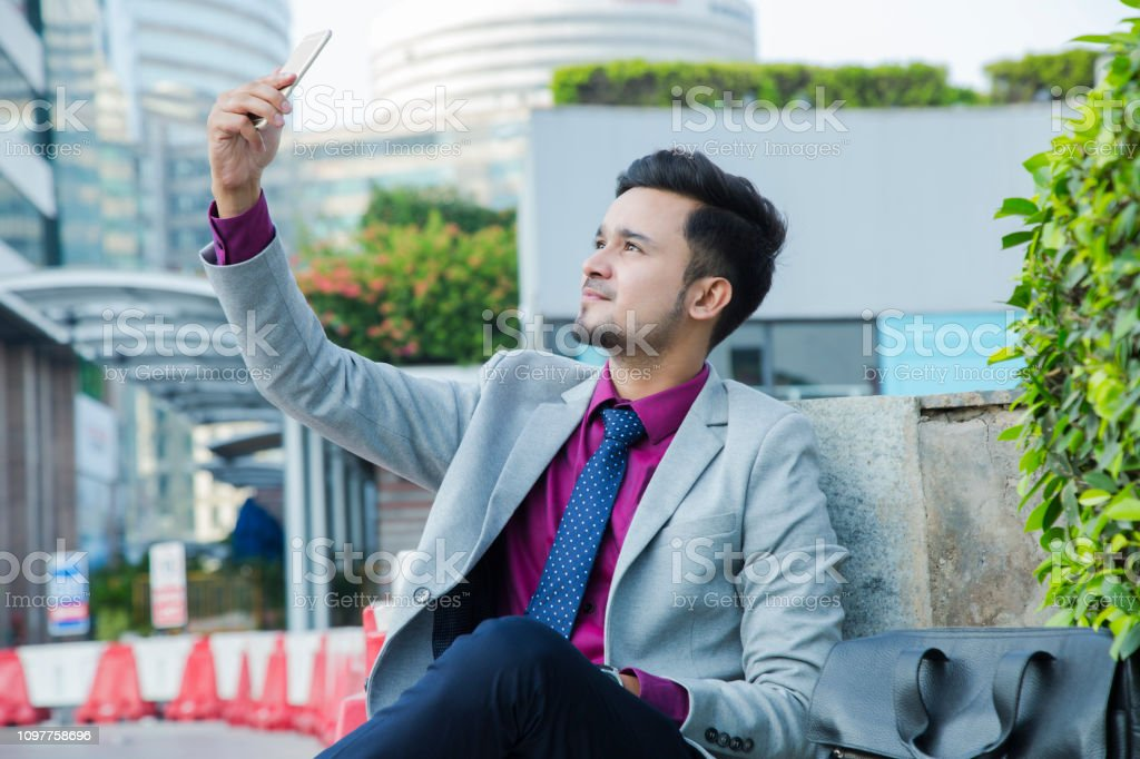 Business man sitting office outside - Stock image Business man, office, modern, lifestyle, Adult Stock Photo